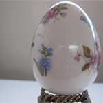 hand painted Limoges porcelain egg on stand