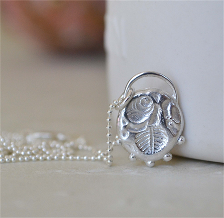 Sterling Silver Rose Relic Pendant.