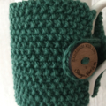 Hand knitted green coffee cozy tea cosy