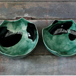 Green bowl with textured surface