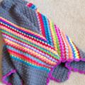 Crochet Baby blanket /pram blanket Grey with Rainbow stripes
