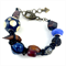 Semi precious stone and wooden beads on woven leather bracelet