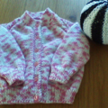 BABY GIRLS PRETTY PINK CARDIGAN IN ACRYIC TO FIT 6 TO 12 MONTHS.