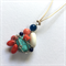 Turquoise, lapis lazuli and coral wire wrapped pendant