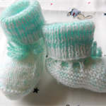 Baby clothing. knitted baby booties. baby socks. Baby shower