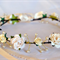 Flower Crown: Ivory and cream flowers with pearl details.