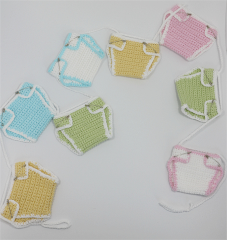 Baby Shower Bunting in yellow, green, blue and pink in a cute nappy style.