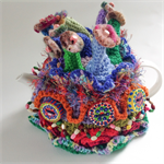 Unique embellished 4-6 cup crochet tea cosy.