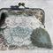 Grey-blue floral clutch bag