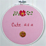 """Cute as a button"" hoop art"