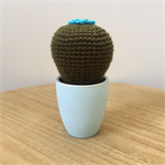 Crochet cactus with blue flower