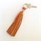 Freya leather tassel key ring: orange with metallic rose gold