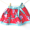 Girls skirt, red blue floral fabric, with bow, size approx 1-2 yrs