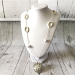 Silver necklace with silver oval beads and large heart charm.