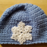 Pure wool crochet baby hat, beanie. Age approx 1-3 mth Cream, Blue. Photo prop.