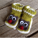 Hand knitted green google eyed baby booties