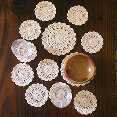 Twelve Piece Set of Hand Crocheted Doilies in Shell Colour