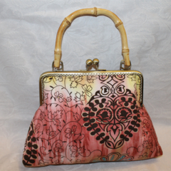 Apricot Batik clutch with bamboo handle
