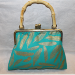Aqua feather clutch with bamboo handle