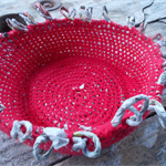 Fringed bowl, hadmade crocheted form made from newspaper yarn and vintage cotton