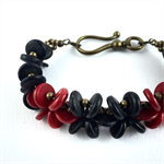 Cinnabar, coral and wood bracelet with bronze hardware