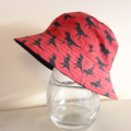 Boys summer hat in red and black dino fabric