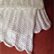 White knitted ripple pattern baby blanket