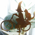 Little Witch on a Bicycle Garden Decoration