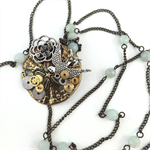 Steampunk Bird Pendant on long chain with pale green semi precious stones
