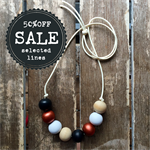 black, white and copper metalic hand painted wooden bead necklace