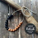 black and light copper metalic hand painted wooden bead necklace