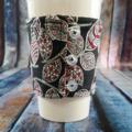 Coffee Cup Wrap: Kiwiwana with red back.