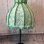 Beautiful apple green and white laced lampshade with vintage embroidered lace.