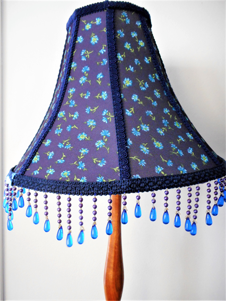 Unique lampshade with heather blue flower fabric and  glacial blue beaded trim.