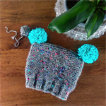 Knitted toddler beanie with pom poms