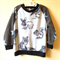 Size 2 Woodland critters with star sleeves fleece jumper