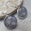 Black White Daisy 16mm Print Glass Earrings hung from silver plated nickel free