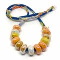 Speckled Egg Ceramic Beads on Kimono Cord - Oranges and Lemons