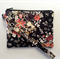 Small black floral wristlet