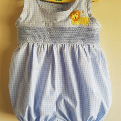 Blue and white checked play suit/romper with smocking & embroidered lion.