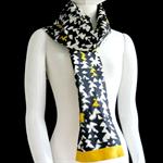 Kasuri (ikat) weave silk scarf in yellow, white and black. Recycled kimono silk