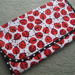 Baby Travel Changemat with pouches for nappies and wipes - Ladybirds - Unisex