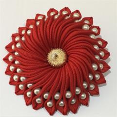 Red ribbon brooch