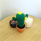 Crochet cactus with yellow flowers in terra-cotta pot