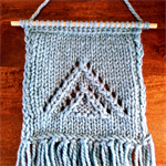 Hand-knitted wall hanging with pyramid pattern | Chunky knit wall art