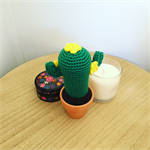 Crochet cactus with yellow flowers in terra-cotta pot