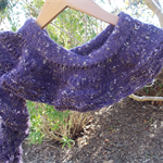 "knitted ""flouncy scarf""  made from poly/acrylic blend yarns"