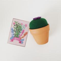 Small crochet cactus with purple flower in terra-cotta pot