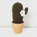 Crochet cactus with pink flowers in terra-cotta pot
