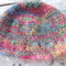 brimmed winter hat crocheted from 92% mohair.  Multi-coloured